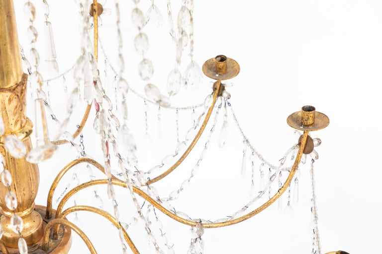 Pair of 18th Century Italian Giltwood and Gilded Iron Chandeliers 1
