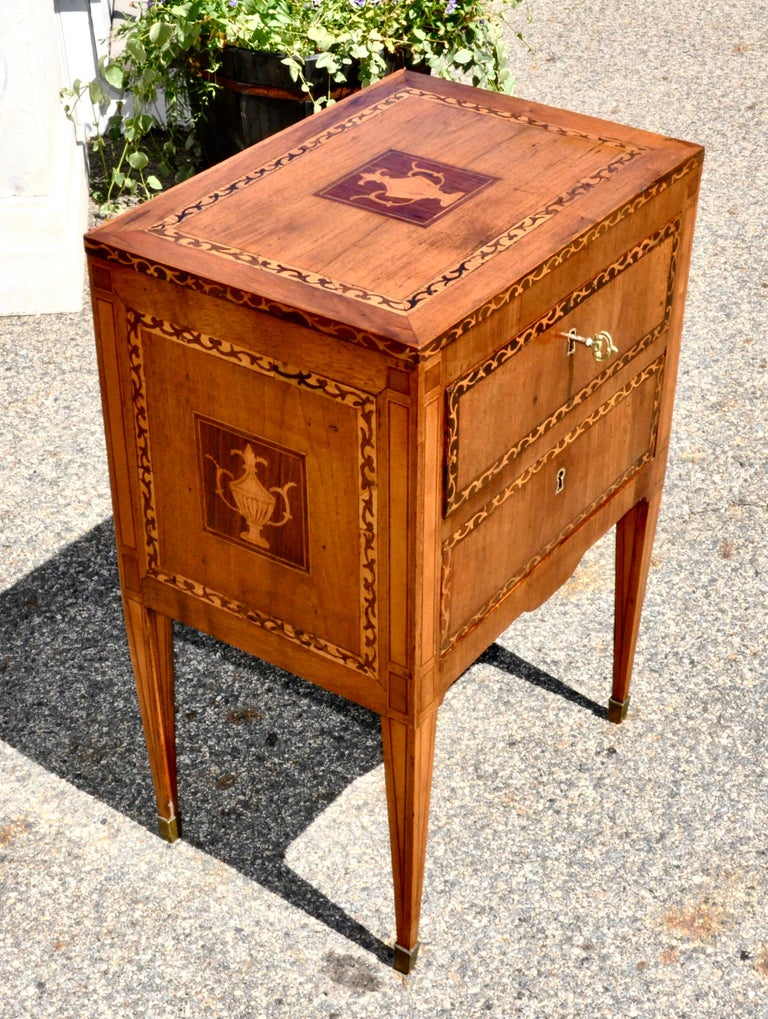 Pair of Northern Italian fruitwood commodes or commodino in marquetry inlay.  Wonderful smaller size suitable as nightstands or end tables. Neoclassical urn inlay and running dog motif.