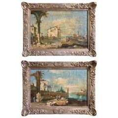 Pair of 18th Century Italian Oil Landscape Scenes in Carved Silvered Frames