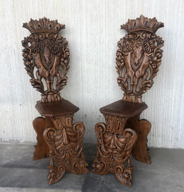 Pair of 18th century Italian Renaissance lion carved walnut Sgabello hall chairs.