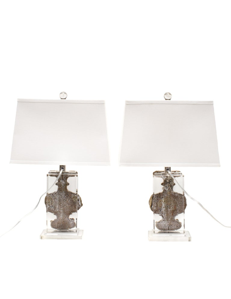 Pair of 18th century Italian silver leaf fragment vases applied to Lucite lamp bases.   The 18th century artifacts vases originally came from a church in Liguria, Italy. They are silver-leafed with hand carved details of angels. The artifacts have
