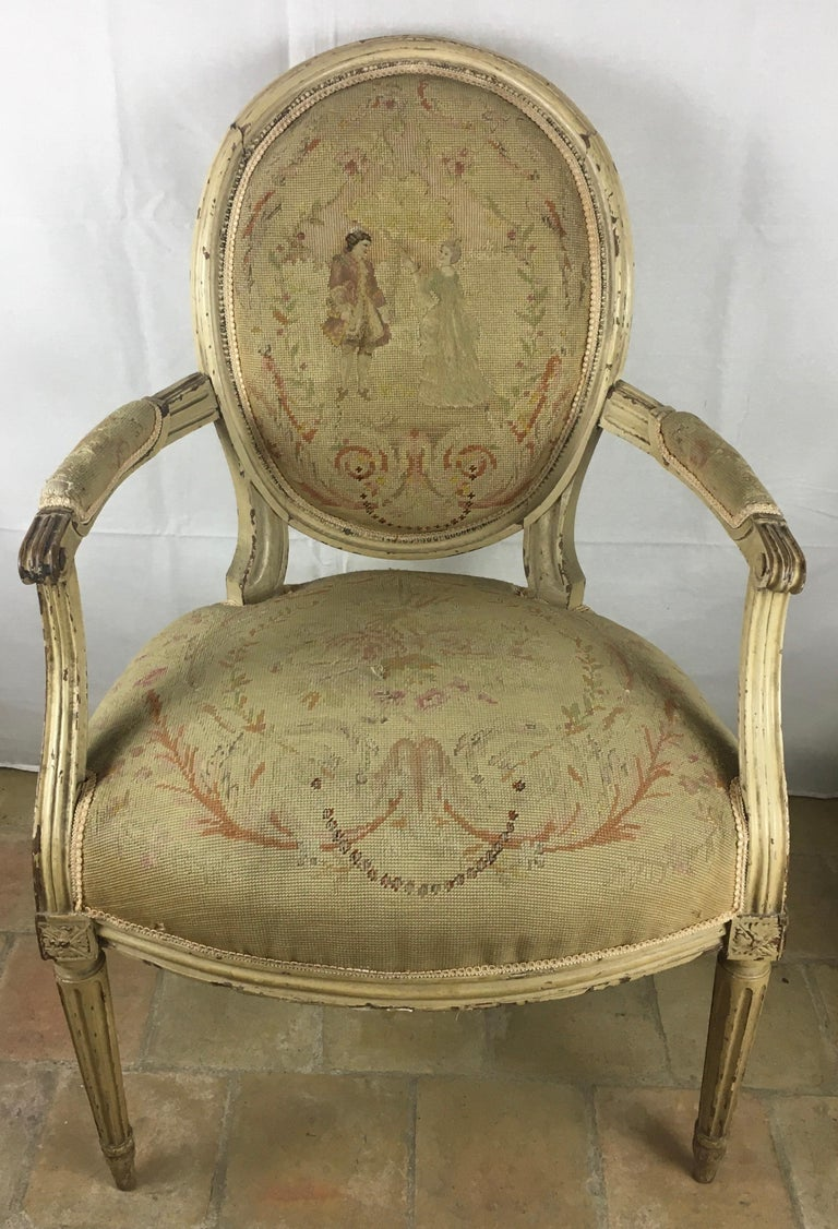 Very fine pair of 18th century French Louis XVI armchairs, scrolled arms, over bow fronted seat, standing on  fluted legs. Retaining mostly original paint and with period needlework upholstery. Presumably Aubusson fabric.    Generous proportions,