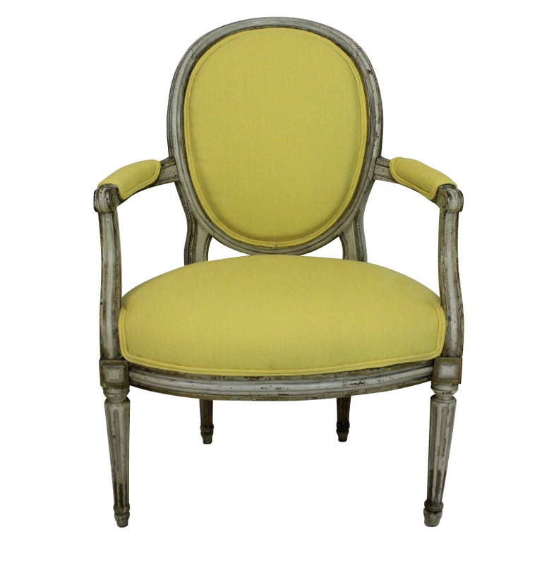 A pair of French 18th century painted armchairs. In their original condition, newly upholstered in Pierre Frey lemon linen.