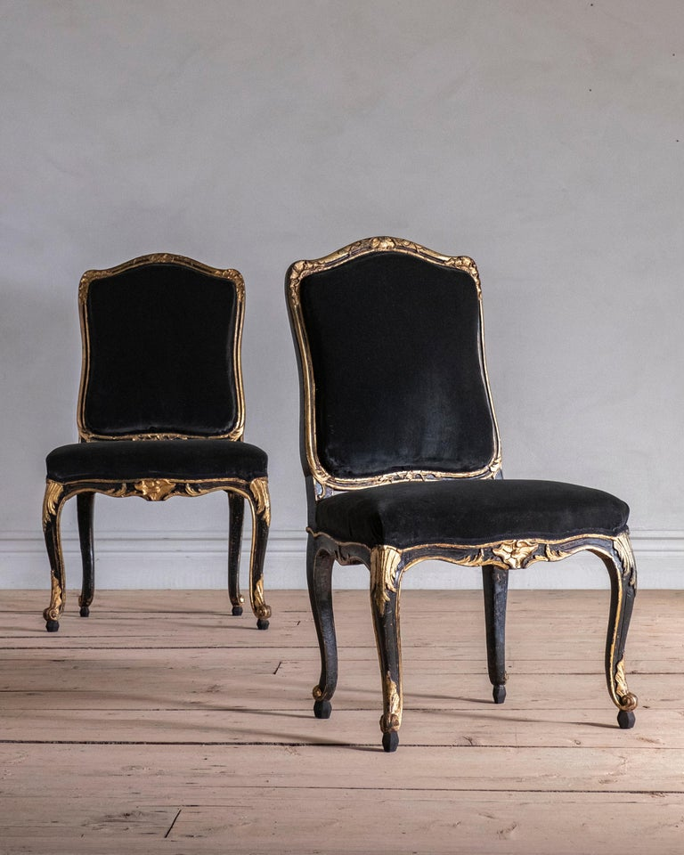Fine pair of Swedish 18th century chairs in good proportions and shape, circa 1760. Good condition and historically restored, circa 1850 where the black and gold was applied. Newly raised feet. Wear and tear consistent with age and use.