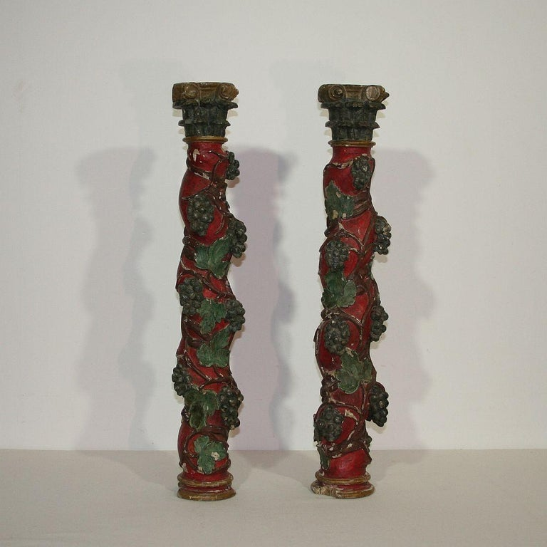 Nice small pair of carved wooden columns, Spain, circa 1750. Weathered, small losses.