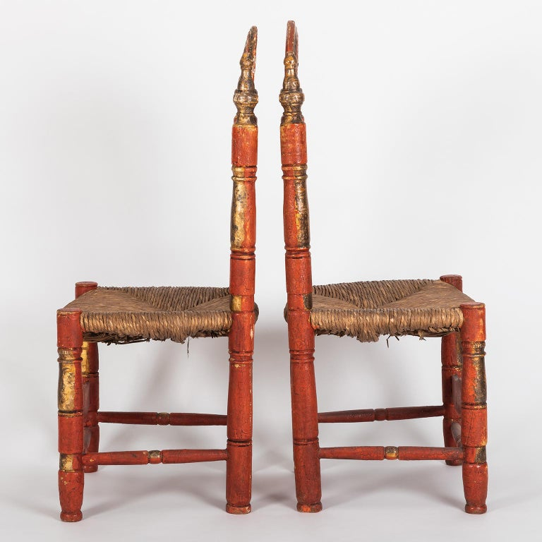 Hand-Carved Pair of 18th Century Spanish Style Ladder Back Painted Chairs with Rush Seats For Sale