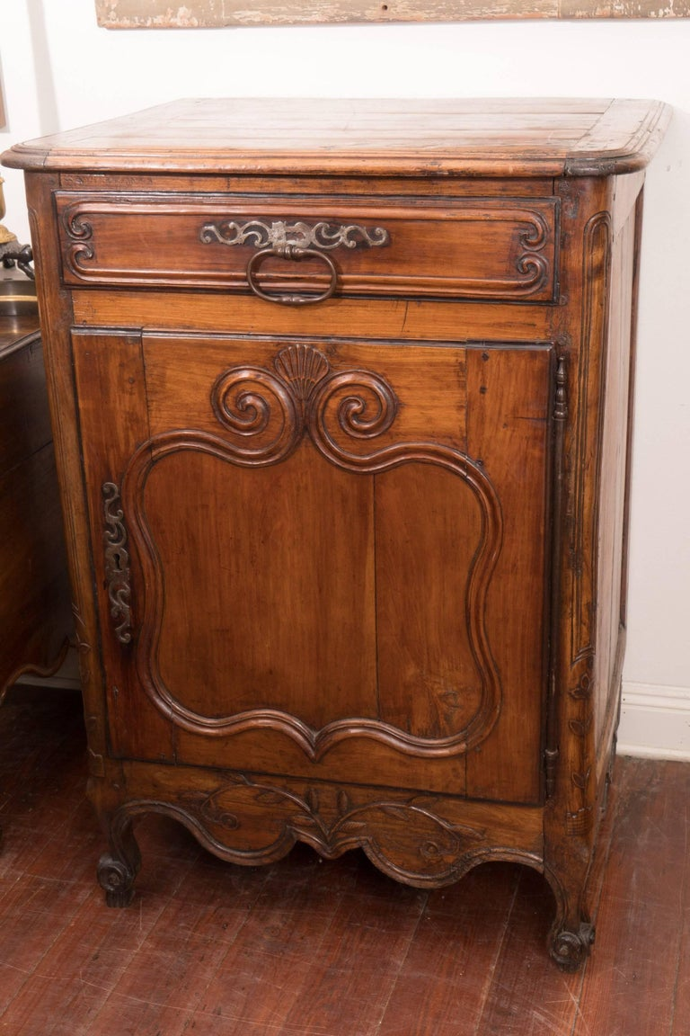 Pair of 18th century walnut cabinets with original hardware and lovely patina.