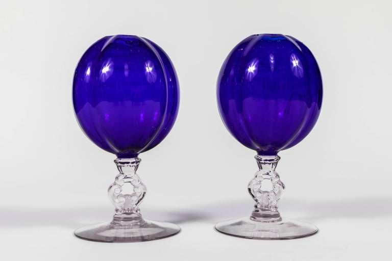 Pair of 1920s cobalt blue glass vases with clear glass stem and foot.
