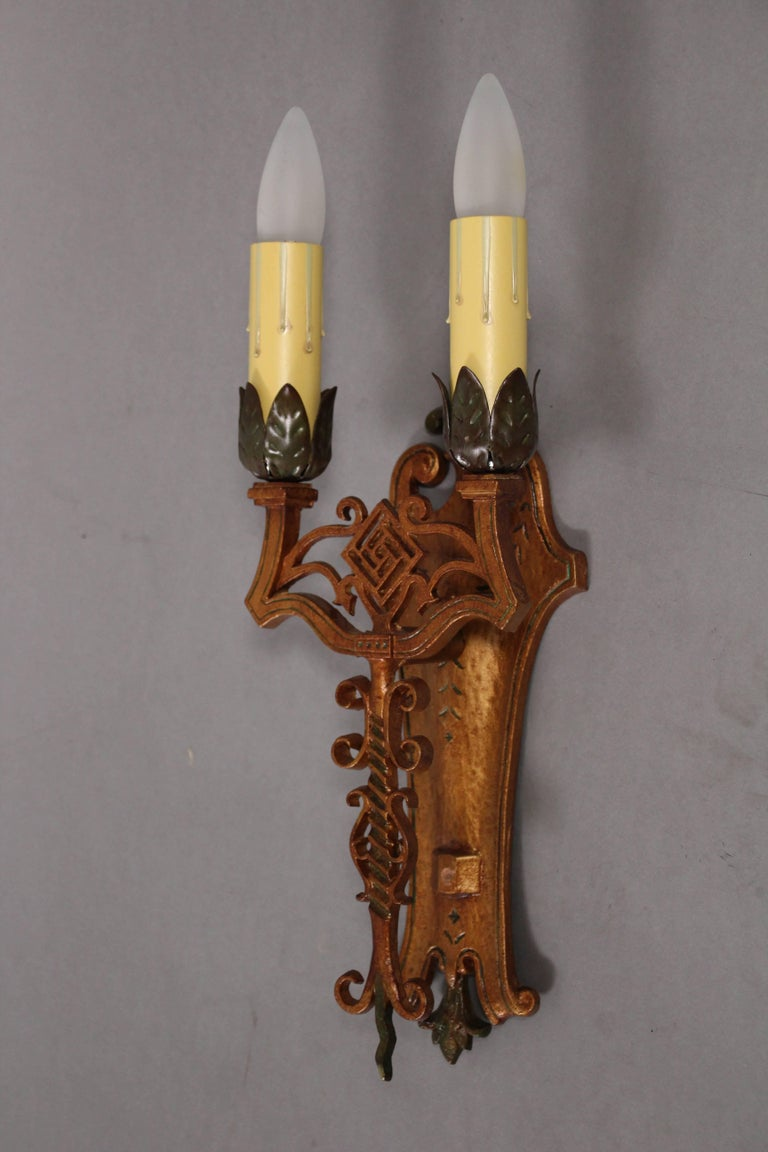 Pair of 1920s sconces with original polychrome finish. Fits nicely in Spanish Revival, English Tudor and Gothic style homes.