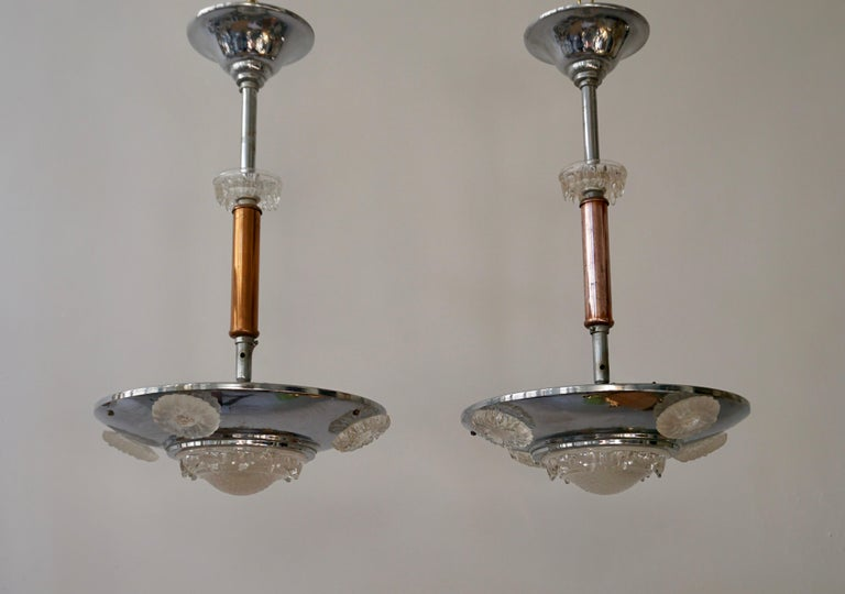 Two Art Deco chandeliers in glass, brass and chrome.  Please note that price is per item not for the set.