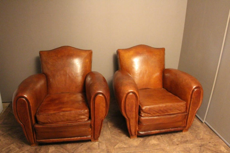 A beautiful pair of Art Deco French chairs in a rich brown patina leather.