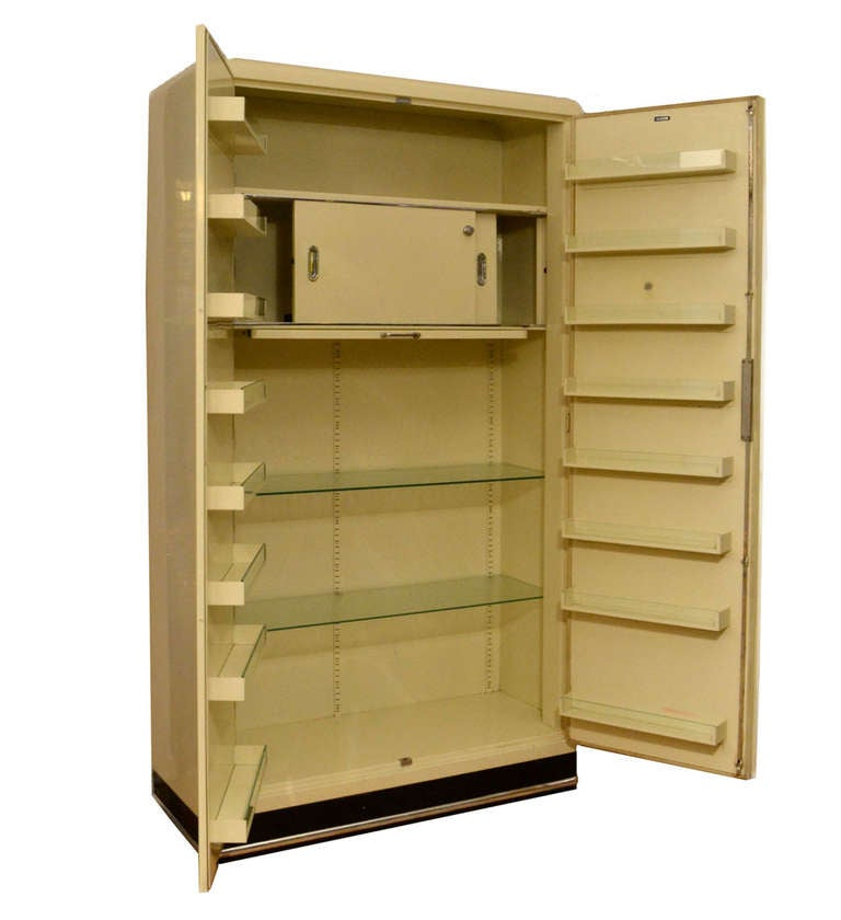 Mid-20th Century Pair of 1930s Modernist Industrial Cream Metal Pharmaceutical Storage Cabinets For Sale