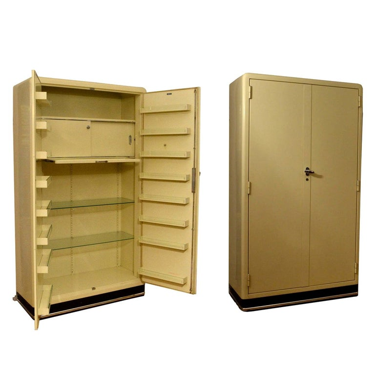 Pair of 1930s Modernist Industrial Cream Metal Pharmaceutical Storage Cabinets For Sale