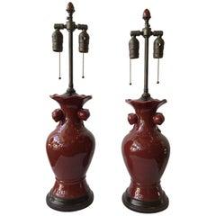 Pair of 1940s Ceramic Oxblood Lamps