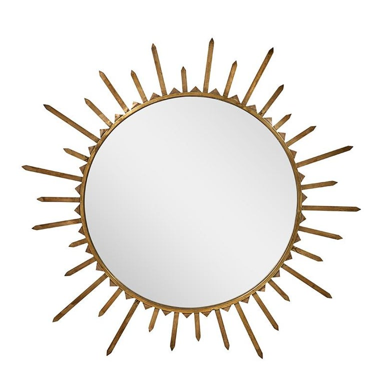 This pair of 1940s brass sunburst mirrors is from France.