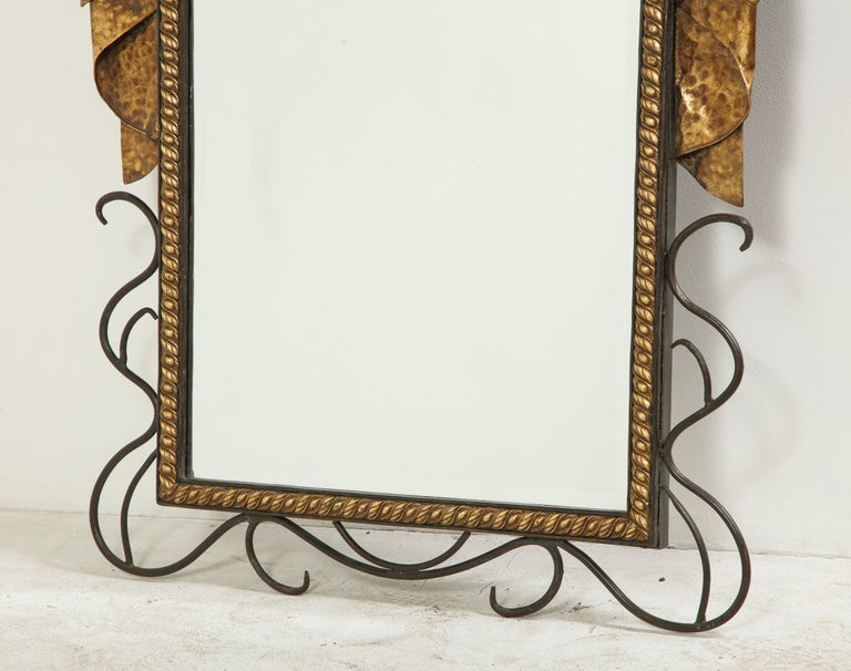 French Pair of Gilbert Poillerat Style Parcel-Gilt and Black Iron Wall Mirrors