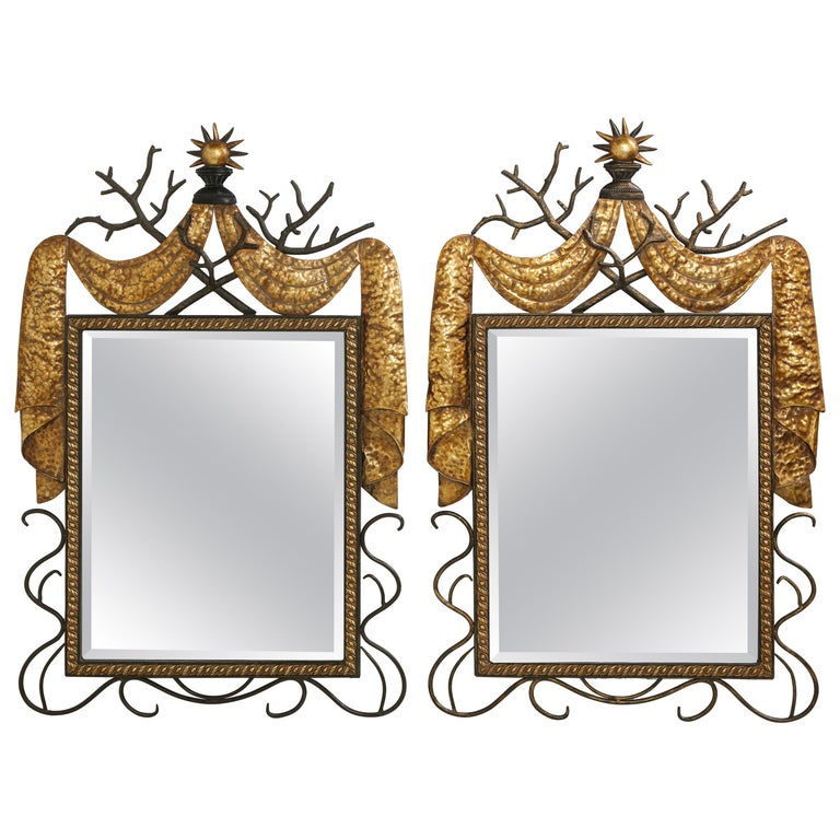 Pair of Gilbert Poillerat Style Parcel-Gilt and Black Iron Wall Mirrors