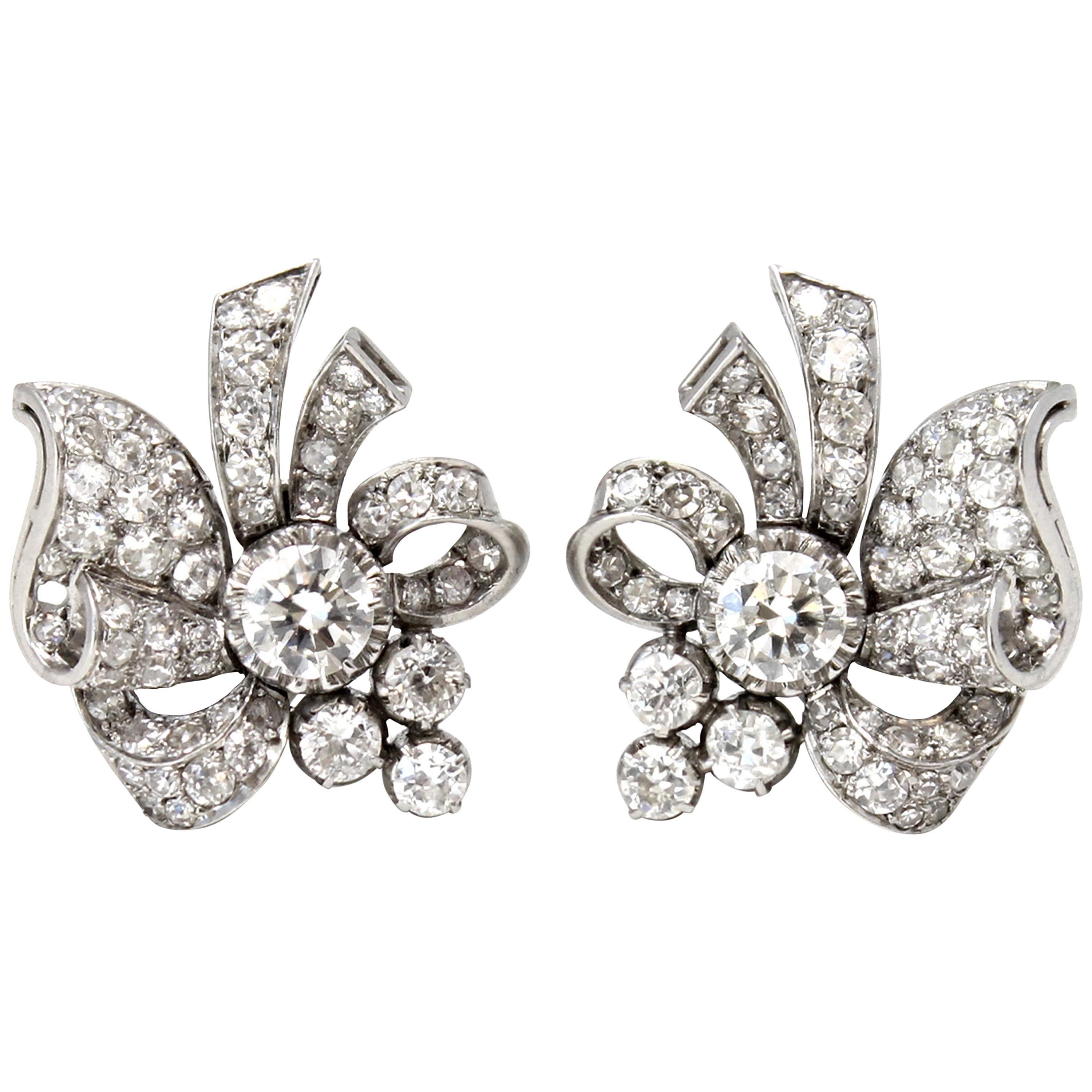 Pair of 1940s Vintage Platinum and 3.50 Carat Diamond Clip Earrings with Scrolls