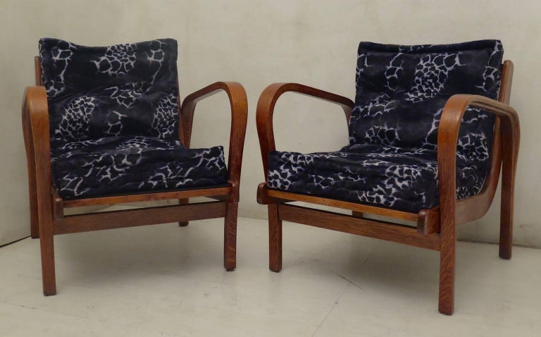 Pair of midcentury Italian armchairs. Very good proportion, with very special fabric for the seat and backrest.  The armchairs are in solid ash wood completely polished in shellac, with a very warm color. Composed of two curved armrests that also