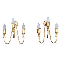 Midcentury design  pair of brass sconces  Arredoluce  Italy 1950s