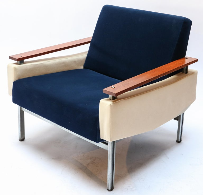 Pair of 1950s Brazilian armchairs with caviuna wood arms and upholstered with blue and beige velvet on a chrome frame.