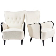 Pair of 1950s Ebonised Boiled Wool Buttoned Armchairs