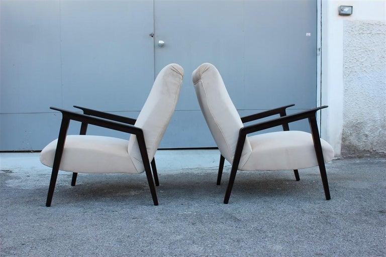 Pair of 1950s Italian design armchairs in walnut and midcentury beige velvet.