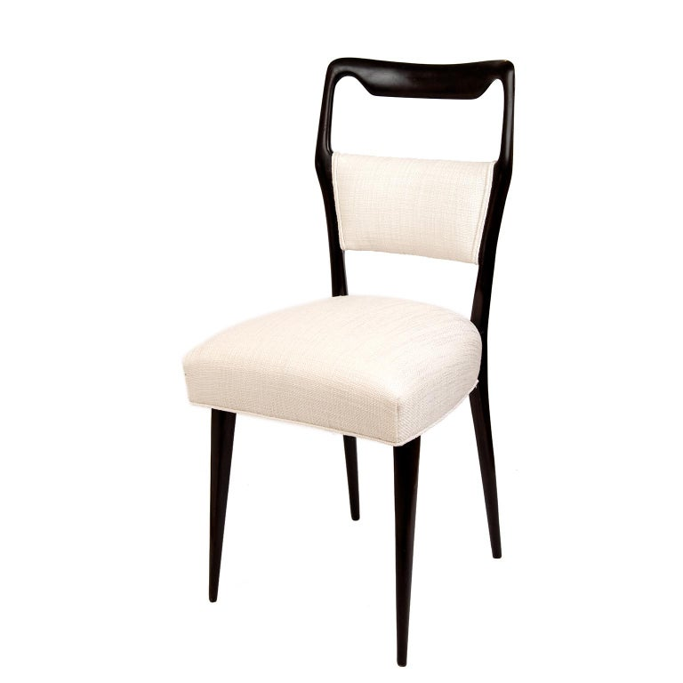 These stunning and sophisticated chairs in dark wood have been expertly reupholstered in a textured white linen fabric. The seats have been re-sprung and provide good support.