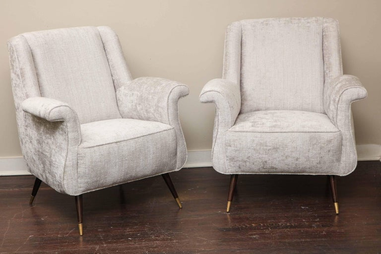 A charming pair of Italian petite rolled armchairs. These chairs are vintage from 1950s and have been reupholstered in platinum velvet.