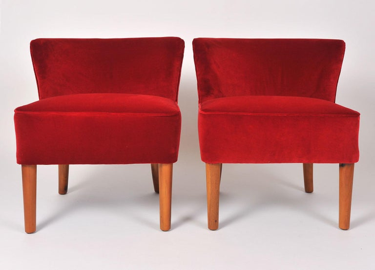 Generous pair of occasional chairs with cherry-wood tapered legs, re-upholstered in red velvet.