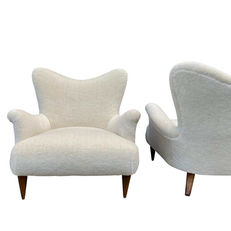 A superb midcentury pair of large, sturdy and comfortable ivory armchairs or lounge chairs from the lobby of an Italian seaside hotel. Upholstered in an off white ivory cotton wool velvet.