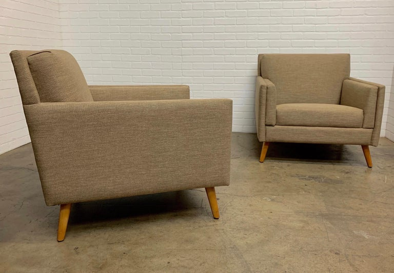 Paul McCobb style chairs very angular with sharp edges and sprawled maple legs and new firm upholstery.