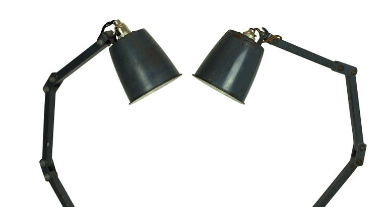 A pair of English memlite articulated lights in their original paint.