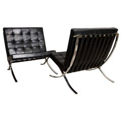 Pair of 1950s Mies van der Rohe Chrome and Black Leather Barcelona Chairs