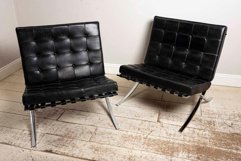 Pair of 1950s Ludwig Mies van der Rohe 'Barcelona' chairs for Knoll international in original black leather quilted upholstery.