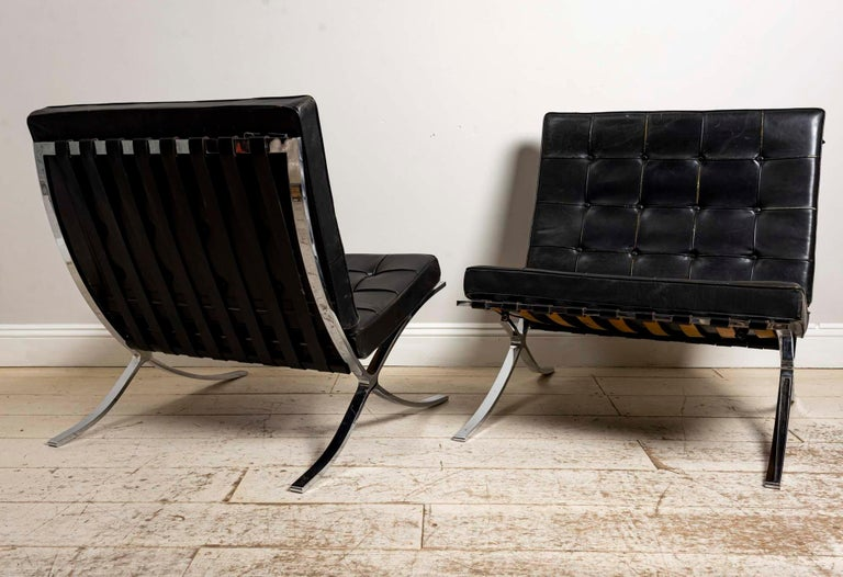 Metalwork Pair of 1950s Mies van der Rohe Chrome and Black Leather Barcelona Chairs For Sale