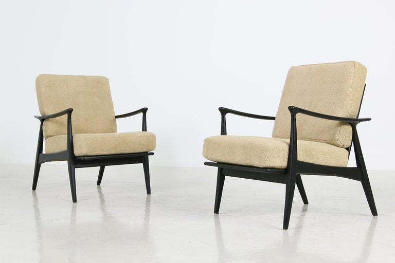 Beautiful pair of 1950s easy chairs, organic shape, new upholstery, covered with new teddy fabric, rare models, solid beech wood, fantastic condition, rare pieces. Were overpainted in black in the late 1990s not perfect but have beautiful patina and