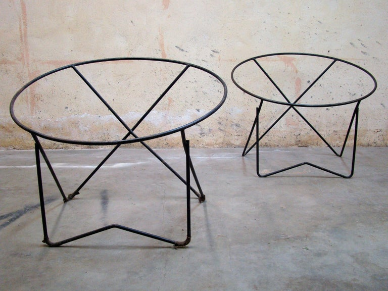 Pair of 1950s steel hoop poolside lounge chairs. Frames only, no upholstery. Paperclip style front legs painted black (original). Upholstery kits are available from various manufacturers online. Measures: 31