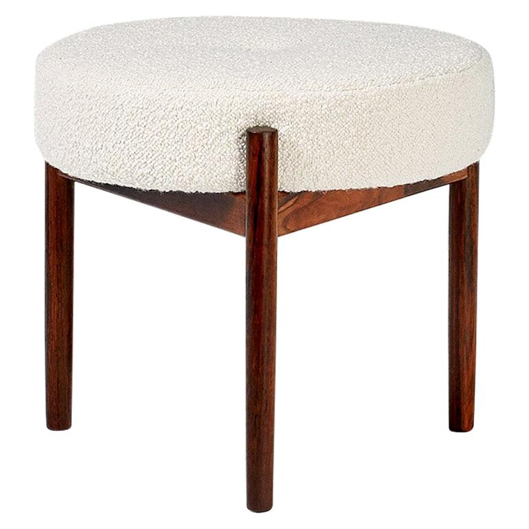 Pair of round ottomans produced in the 1950s in Denmark by Spottrup Mobler. Features 3-leg rosewood frame with round seat pad covered in new Italian bouclé wool fabric.