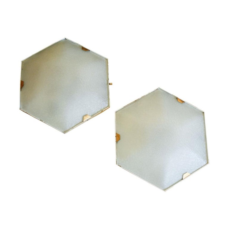 A pair of hexagonal flushmount / sconce stamped Stilnovo Model 1183 lacquered metal polished brass with etched glass made in Italy, 1965.