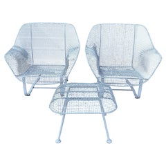 Pair of 1950's Woodard Sculptura Wide Lounge Chairs and Ottoman