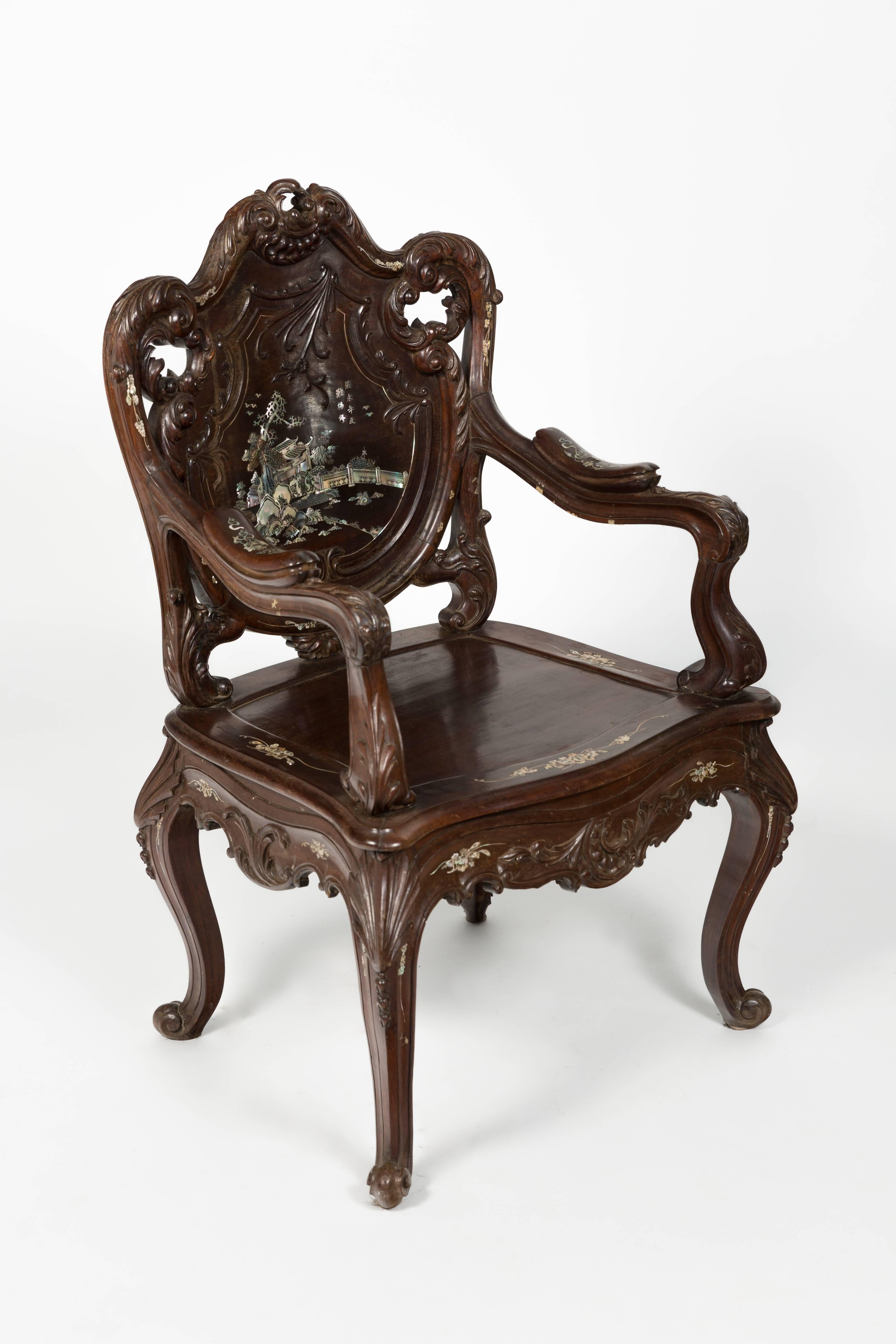 Pair Of Highly Carved Rosewood Chairs With Mother Of Pearl Inlay. Mother
