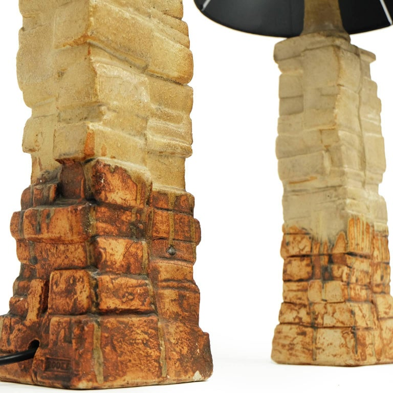 Pair of table lamps designed and manufactured by Bernard Rooke, UK.  Handmade ceramic sculptural design with brown glazed detail.  Measures: With shade H 61 cm x W 28 cm. Without shade H 46 cm x W 12 cm x D 10 cm.