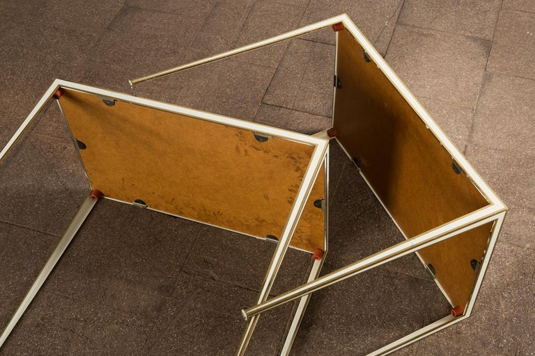 Pair of Mid-Century side tables with Mirror Glass tops by Vereinigte Werkstätten  This pair of side tables was produced by Vereinigte Werkstätten München in the 1960s. The tables are made of brass structures, the tops are made of mirrored glass. One
