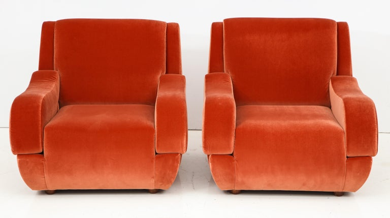 Elegant pair of vintage Italian lounge chairs with sculptural midcentury Italian design in the style of Ico Parisi. Completely restored and newly reupholstered in a Vermillion colored imported soft velvet. Comfortable and sturdy. This pair of