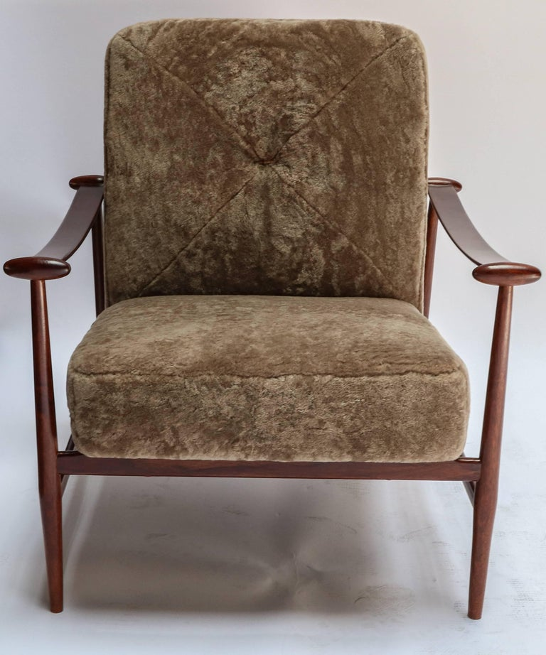 Pair of 1960s Brazilian armchairs by Liceu de Artes upholstered in tan sheepskin.