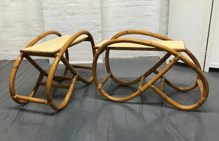 Pair of 1960s rattan end tables. The tables have bent rattan frames and the tops are laminated. Style of Paul Frankl.