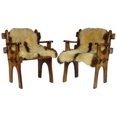 Pair of 1960s Scandinavian Teak Armchairs with Sheepskin