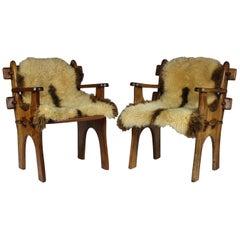 Pair of 1960s Scandinavian Teak Armchairs with Sheepskin