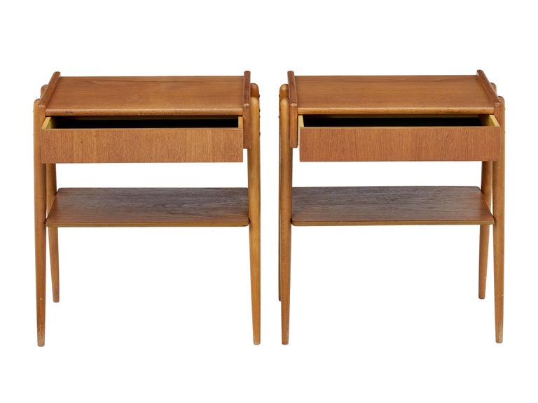 Fine pair of Scandinavian teak bedside tables, circa 1960.  Teak top surface with single drawer below. Design allows the leg structure on the outside which supports the shelf.  Minor surface marks.